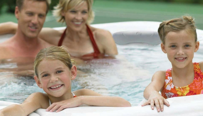 kids in hot tub with parents